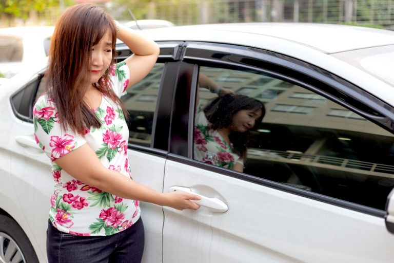 distressed woman outside car needs locksmith